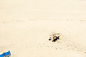 Couple sunbathing on white sandy beach. Couple sunbathing on white sandy beach