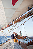 two couples sitting on deck of a boat