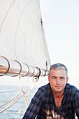 man on a sailing boat looking at viewer