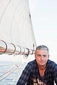 man on a sailing boat looking at viewer