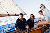 two couples on a sailing boat smiling