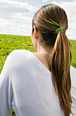 Woman with grass tied in hair
