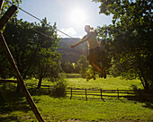 girl on a swing on farm. girl on a swing on farm
