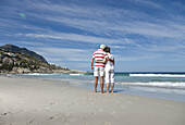 Older couple hugging on beach. Older couple hugging on beach