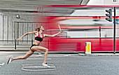 Athlete carrying baton on city street. Athlete carrying baton on city street