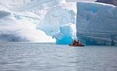 Men kayaking near glaciers. Men kayaking near glaciers