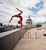 Gymnast on urban rooftop. Gymnast on urban rooftop