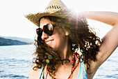 Woman in straw hat smiling on beach. Woman in straw hat smiling on beach