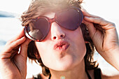 Woman in sunglasses posing on beach. Woman in sunglasses posing on beach