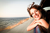 Woman smiling out of car window. Woman smiling out of car window