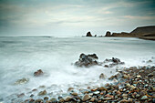 Time lapse view of waves on rocky beach. Time lapse view of waves on rocky beach