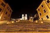 Spanish Steps lit up at night. The Spanish Steps Italian: Scalinata della Trinità dei Monti up to the Church of Trinità dei Monti