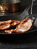 English bacon in frying pan. Back Bacon being Fried