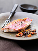 Close up of red mullet with wild rice. Red Mullet with a wild ricelentils and carrots salad