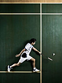 Badminton player laying on court. Badminton player lying on the floor