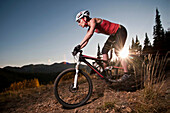Mountain biker on dirt path. Wasatch Crest Trail