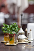 Glasses of mint tea on table. Moroccan Mint Tea, Marrakech, Morocco