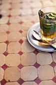 Glass of mint tea on restaurant table. Mint tea, Marrakech, Morocco