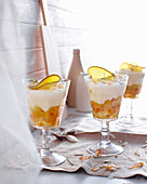 Glasses of mango coconut trifle. MangoCoconutTrifle