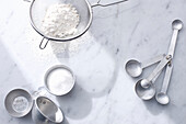 Flour with measuring cups and spoons. QSCOpenerBasics
