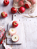 Sliced apples on wooden board. Apples