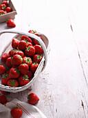 Basket of strawberries on table. Strawberries