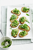 Plate of toast with pea and leek. PeaLeekCrostini