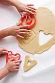 Children making cookies in letter shapes. ABCKidsCooking