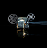 Glowing movie projector with reel. Movie Projector, Cine film, Technology, Still Life