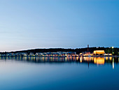 City lights reflected in still water. Landscape Lake Vesijärvi Finland