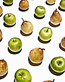 Apples and pears in grid pattern. Still Life, Apples, Green apples, Green,Pears, Yellow pears, Yellow Fruit, Food, Fresh,White,Graphic, Shadows, Granny smith apples, Art,Photo,Design