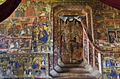The monastery Ura Kidane Meret, Zege peninsula of Lake Tana in Ethiopia  the church is beautifully painted  The frescos are showing stories of the new and old testament as well as miracles of saints  All saints, angels or people are painted with black ski