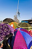 Meskel Cerimony in Lalibela Meskal, Meskal, Maskal, Mescel, Mesquel, which is taking place every September  For Meskel many pilgrims are coming to lalibela, to celebrate it at one of the holy palces in Ethiopia  Traditional colorful sunshades of the clerg