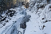 The Krimml waterfalls in the National Park Hohe Tauern during winter in ice and snow  The middle Fall  The Krimml waterfalls are one of the biggest tourist attractions in Austria and the Alps  They are visited by around 400 000 tourists every year  The wa