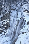 The Krimml waterfalls in the National Park Hohe Tauern during winter in ice and snow  The upper Fall  The Krimml waterfalls are one of the biggest tourist attractions in Austria and the Alps  They are visited by around 400 000 tourists every year  The wat