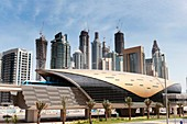 View of Dubai metro train and office towers in financial district of Dubai United Arab Emirates UAE