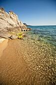 rocky coast and beach at the small holiday resort of Toroni, Sithonia, Greece