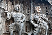 Carved statues, Fengxian Temple, Longmen Grottoes and Caves, Luoyang, Henan Province, China  Tang Dynasty