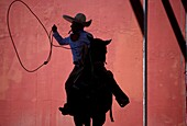 A Mexican charro practices his lasso at the National Charro Championship in Pachuca, Hidalgo State, Mexico. Escaramuzas are similar to US rodeos, where female competitors called ´Amazonas´ wear long skirts, and ride side saddle Male rodeo competitors are