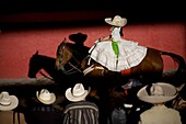 Spectators watch a Mexican amazona ride her horse at the National Charro Championship in Pachuca, Hidalgo State, Mexico. Escaramuzas are similar to US rodeos, where female competitors called ´Amazonas´ wear long skirts, and ride side saddle Male rodeo com