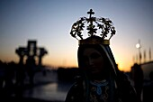 A statue of Our Lady of Guadalupe is silhouetted against the sunrise in Mexico City, December 10, 2010  Hundreds of thousands of Mexican pilgrims converged on the Basilica, bringing images to be blessed, as processions filled the streets for the feast day