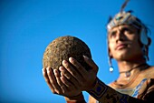 A Mayan ball player holds up the ball made of hule, natural rubber, in Chapab village in Yucatan state in Mexico´s Yucatan peninsula, June 14, 2009