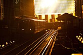 Sunrise illuminates the elevated tracks of the Chicago rapid transit system known as the´L´ in Chicago, IL, USA