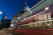 St  Paul´s Cathedral at night, from the south, with motion blur bus lights, London, United Kingdom