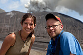 Roland Schulz, author for German GEO and Ulla Lohmann, photographer. Tavurvur Volcano, Rabaul, East New Britain, Papua New Guinea, Melanesia, Pacific