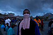 Man with dust mask, Market in Rabaul, Tavurvur Volcano, Rabaul, East New Britain, Papua New Guinea, Pacific