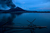 On the way to work. Egg hunters paddle across from Matupit to the volcano every day to dig for eggs. Tavurvur Volcano, Rabaul, East New Britain, Papua New Guinea, Pacific