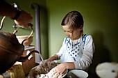 Girl preparing pizza dough, Klein Thurow, Roggendorf, Mecklenburg-Western Pomerania, Germany