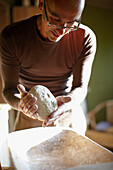 Man kneading bread dough, Klein Thurow, Roggendorf, Mecklenburg-Western Pomerania, Germany