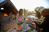 People preparing pizza, Klein Thurow, Roggendorf, Mecklenburg-Western Pomerania, Germany